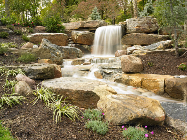 Custom designed waterfalls by Aching Acres Landscaping