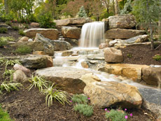 Natural Stone waterfall by Aching Acres Landsaping