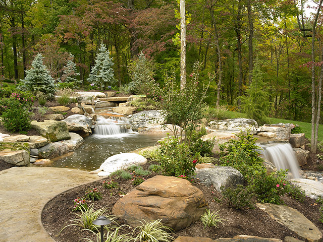 Natural Stone Wading Pool and Waterfall System by Aching Acres Landsaping