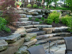 Natural stone ledge rock walls by Aching Acres Landscaping
